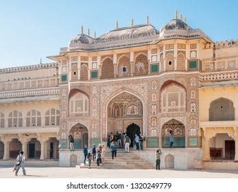 JAIPUR, INDIA - FEBRUARY 2, 2011: Tourists at Ganosh Pol, a famous palace in the first courtyard of Amer Fort in Jaipur. Amer Fort or Amber Fort is a a UNESCO World Heritage site.