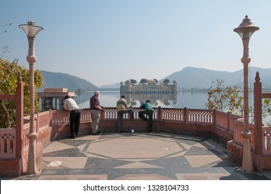 JAIPUR, INDIA - FEBRUARY 2, 2011: Tourists admire Jal Mahal, the Water palace, which is a 300 years old iconic building in lake Man Sagar in Jaipur, India.
