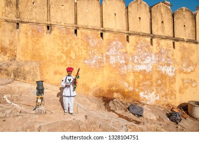 JAIPUR, INDIA - FEBRUARY 2, 2011: Man with traditional instrument at Amer fort or Amber fort completed in 1592 was the residence of the Rajput Maharajas in Jaipur. It is a UNESCO World Heritage site.