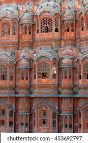 JAIPUR, INDIA - FEBRUARY 23, 2006: A woman and a child , overlook one of the windows of the Palace of Winds or Hawa Mahal