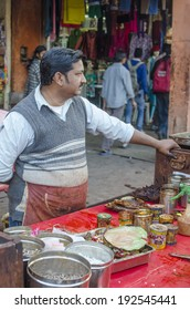 Jaipur, India - February 27, 2014 - Vendors selling paan or betel leaf and betel nut as mouth freshener from their stall along busy street