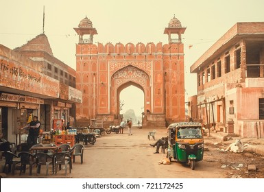 JAIPUR, INDIA - JAN 22: Street life and historical city gate, local food store in poor area of indian city on January 22, 2016. Jaipur, with population 6,664,000 people, is a capital of Rajasthan