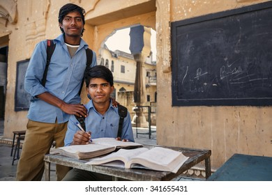 JAIPUR, INDIA - JANUARY 10, 2015: Two Indian male students with books on January 10, 2015 in Jaipur, India