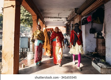 JAIPUR, INDIA - JANUARY 10, 2015: Women walking on street on January 10, 2015 in Jaipur, India