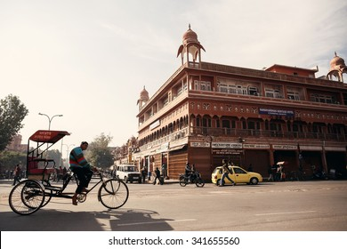 JAIPUR, INDIA - JANUARY 10, 2015: Man riding cycle rickshaw on street on January 10, 2015 in Jaipur, India