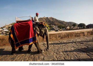 JAIPUR, INDIA - JANUARY 10, 2015: Men on elephants near Amer Fort on January 10, 2015 in Jaipur, India