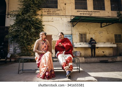 JAIPUR, INDIA - JANUARY 10, 2015: Two Indian mature women sitting on bench on January 10, 2015 in Jaipur, India