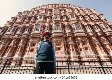 JAIPUR, INDIA - JANUARY 10, 2015: Indian senior man near Hawa Mahal palace (Palace of the Winds) on January 10, 2015 in Jaipur, Rajasthan, India
