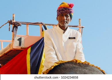 JAIPUR, INDIA - JANUARY 10, 2018: Mahout (elephant rider) in traditional rajasthani turban rides an elephant in Amber fort.