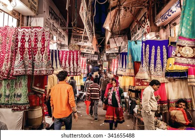 JAIPUR, INDIA - JANUARY 9, 2015: People in local textile shop of traditional indian sari on January 9, 2015 in Jaipur, India