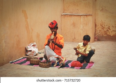 JAIPUR, INDIA - JULY 3, 2009: Snake Charmers at amber fort in Jaipur