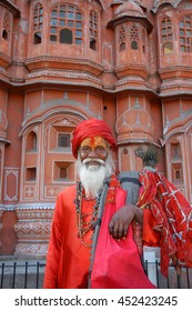 JAIPUR, INDIA - MARCH 08, 2006: A Hindu ascetic, near the Palace of the Winds , Hawa Mahal of Jaipur