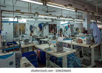 Jaipur, India - March 1, 2018: Sewing Sweatshop Factory for Garments and Craft Production