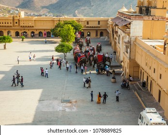 Jaipur, India - March 10, 2018: Tourists visiting and riding the elephants at Amber Fort in Jaipur city, Rajasthan State, India.