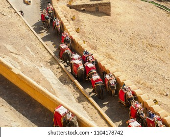 Jaipur, India - March 10, 2018: Tourists visiting and riding the decorated elephants at Amber Fort in Jaipur city, Rajasthan State, India.