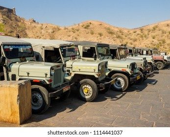 Jaipur, India - March 10, 2018: The jeeps parking at the Amber Fort  waiting for tourists visiting Amber Fort in  Jaipur city, Rajasthan State, India.