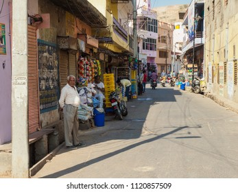 Jaipur, India - March 10, 2018: The unidentified people at the street near the Amber Fort with full of street retailers on the hot sunny day.