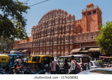 Jaipur, India - March 10, 2018: The traffic and busy street in front of Hawa Mahal or Palace of Winds or Palace of Breeze or Pink Palace in Jaipur city, Rajasthan State, India.