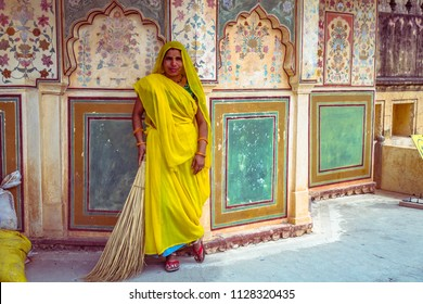 JAIPUR, INDIA - MARCH 15, 2016 : Sweeper lady in traditional clothes / sari poses at Amber fort in Rajasthan, India