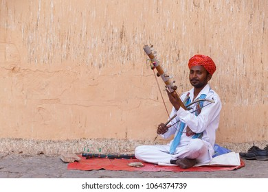 JAIPUR, INDIA - MARCH 15, 2018: Indian musician playing musical instrument in Jaipur