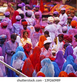 JAIPUR, INDIA - MARCH 17: People covered in paint on Holi festival, March 17, 2013, Jaipur, India. Holi, the festival of colors, marks the arrival of spring, one of the biggest festivals in India