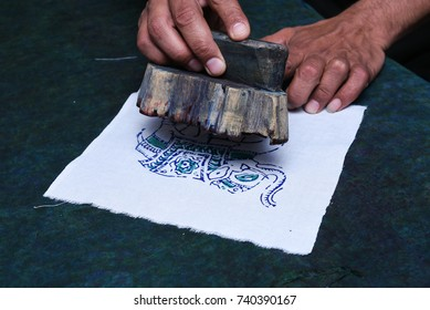 JAIPUR, INDIA - MAY 10: Indian man doing wood Block Printing for Textile in India by hand traditional handicrafts on linen, cotton or silk textile to create a pattern on May 10, 2017 Rajasthan Delhi.