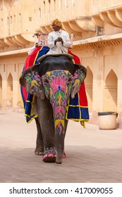 JAIPUR, INDIA - NOVEMBER 10, 2012: Decorated elephant and elephant driver on the road at Amber Fort in Jaipur, Rajasthan, India