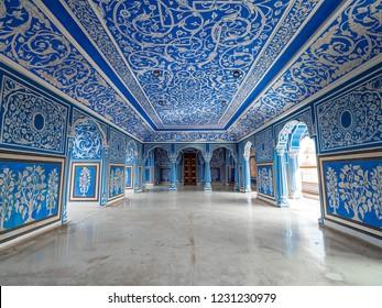 Jaipur, India - November 12, 2018: : City Palace Jaipur inner hallway with blue pattern decorative wall art paintings.
