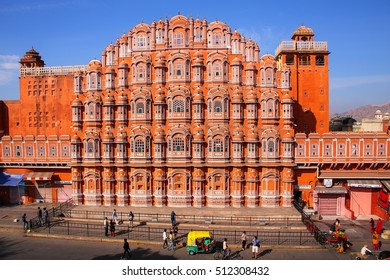JAIPUR, INDIA - NOVEMBER 14: Unidentified people walk near Hawa Mahal on November 14, 2014 in Jaipur, India. Hawa Mahal was designed by Lal Chand Ustad in the form of the crown of Krishna