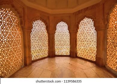 Jaipur, India - November 17, 2017: Design of old windows inside Amer fort.