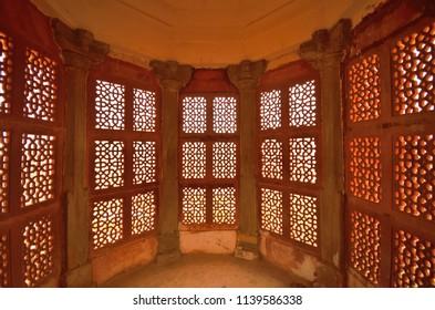 Jaipur, India - November 17, 2017: Pattern of old windows inside Amer fort.