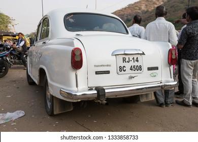 Jaipur, India - November 21, 2018: Ambassador car parked on the street near Monkey Temple in Jaipur.