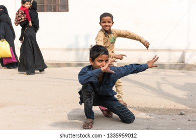 Jaipur, India - November 22, 2018: Two happy boys playing on the street of Jaipur.