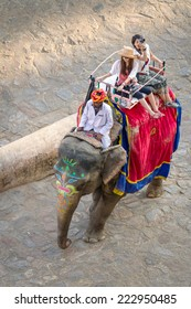 JAIPUR, INDIA - NOVEMBER 26: Tourists on an elephant ride tour near by the palace of the Amber Fort on November 26, 2012 in Jaipur, India.