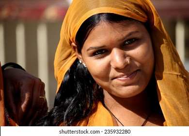 Jaipur, India, November 30, 2012: Beautiful Indian girl with traditional colorful sari, looking at the camera, in the Indian Rajasthan state