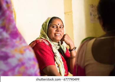 JAIPUR, INDIA -  NOVEMBER 7, 2016: An indian woman is smiling while she learns to read and write at the NGO Saksham in Jaipur