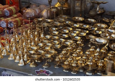JAIPUR, INDIA - OCT 11, 2017 - Lamps, statues and other objects for worshippers at a shop outside the Govind Temple,  Jaipur, Rajasthan, India