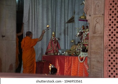 JAIPUR, INDIA - OCT 12, 2017 - Brahmin priest conducting darshan at the Govind Temple,  Jaipur, Rajasthan, India