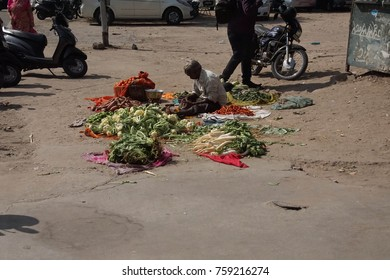 JAIPUR, INDIA - OCT 12, 2017 - Man selling vegetables in the market of  Jaipur, Rajasthan,  India