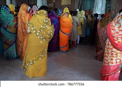 JAIPUR, INDIA - OCT 12, 2017 - Brightly colored saris of women at darshan at Govind Temple,  Jaipur, Rajasthan, India