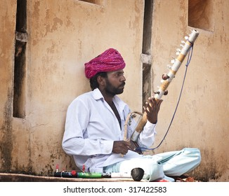 JAIPUR, INDIA - OCT, 28th ,2014: Rajasthani man poses with traditional Rajstani instrument inside Amer Fort on October 28th , 2014 . Iit is the principal tourist attractions in the Jaipur