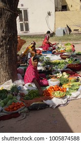 JAIPUR, INDIA - OCT 8, 2017 - Women selling vegetables in the market of  Jaipur, Rajasthan, India