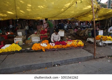 JAIPUR, INDIA - OCT 8, 2017 - Flower sellers prepare for the Divaali holiday in  outside Govind Devji Temple,  Jaipur, Rajasthan, India