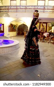 JAIPUR, INDIA - OCT 8, 2017 - Rajasthani dancer with fire pot on her head,  Jaipur, Rajasthan, India
