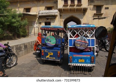 JAIPUR, INDIA - OCT 8, 2017 - Blue auto rickshaw tuktuks In traffic in  Jaipur, Rajasthan, India