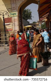 JAIPUR, INDIA - OCT 8, 2017 - Women in colorful saris  outside Govind Devji Temple,  Jaipur, Rajasthan, India