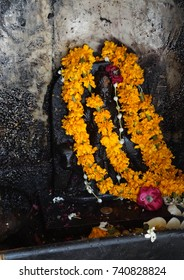 JAIPUR, INDIA - OCT 8, 2017 - Shiva altar with marigolds  outside Govind Devji Temple,  Jaipur, Rajasthan, India