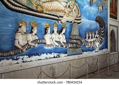 JAIPUR, INDIA - OCT 8, 2017 - Statues from Hindu myth of churning the milk sea, Sindhi Temple,  Jaipur, Rajasthan, India