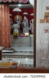 JAIPUR, INDIA - OCT 9, 2017 - Dressing the god in the morning, Khole Ke Hanuman Ji Temple,  Jaipur, Rajasthan, India