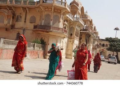 JAIPUR, INDIA - OCT 9, 2017 - Hindu women approach Galtaji temple, Jaipur, Rajasthan, India